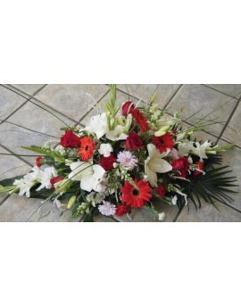 Funeral arrangement in red and white